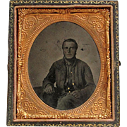 Early Tintype photograph- Civil War Soldier In Half Embossed Case