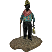 Primitive Black Americana Folk Art Figurine Carving of Ederly Man With Lantern & Cane.