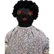 Nice Old Folk Art Straw Stuffed Black Cloth Doll.