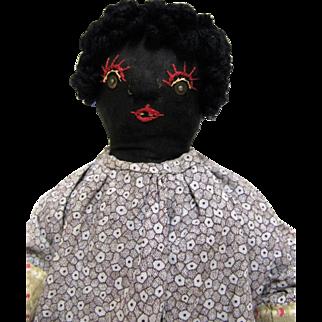 Nice Old Folk Art Straw Stuffed Black Cloth Doll.