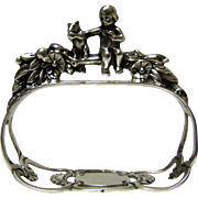 Sterling Silver W.German Figural Napkin Ring-Cherub and Squirrel.