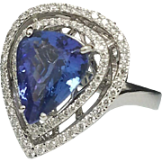 Stunning Handcrafted Pear Cut 3.53 Carat Natural Tanzanite & Diamond 14 Karat White Gold Halo Cocktail Ring.
