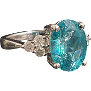 Stunning Handcrafted 14 Karat White Gold 6.00 Carat Oval Cut Paraiba Blue Apatite & Diamond Accented Ring.