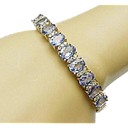8.00 Carat Tanzanite and .25 Carat Diamond Bangle in 14KT Yellow Gold