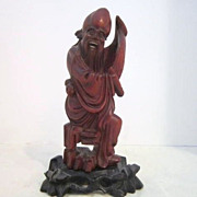 Vintage Chinese Wood Carving of a Scholar Holding a Scroll