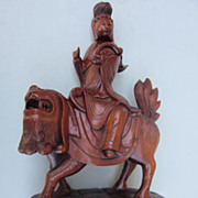 Vintage Chinese Wood Carving of A Lady Riding a Mythical Lion