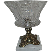 Cut Crystal Bowl with Gilt Metal Base Set on White Marble