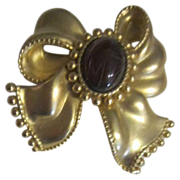 Goldtone Brooch Ribbon with Etched Glass Center
