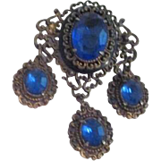 "Antique Brooch with Mounted Faceted Blue Glass ""Stones"" Set in Filigree"