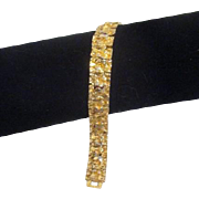 Goldtone Band Bracelet Intricate Design
