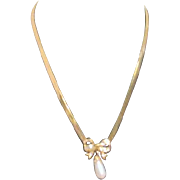 Gold Plated Flat Chain Necklace with Rhinestones and Faux Pearl Pendant