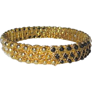 Solid Bracelet with Black White and Goldtone Beading
