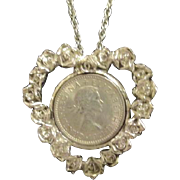 "Silvertone Heart Shaped Pendant with 1964 English Pence Coin on 23"" Chain"