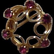 Round Goldtone Brooch with Pink Rhinestones