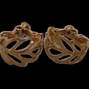 Napier Pair of Open Work Curled Leaf Screw-on Goldtone Earrings