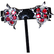 Pair of Sarah Coventry Clip-on Silvertone and Red Iridescent Leaf Earrings