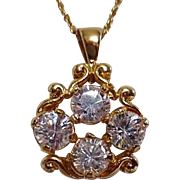 "Goldtone Pendant with 4 large CZ's on 18"" chain"