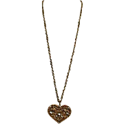 Avenue Goldtone Filigree Heart Shaped Pendant Accented with Rhinestones and Flowers on Chain