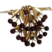 Austrian Gold Toned Brooch with Glass Berries and Green Rhinestones