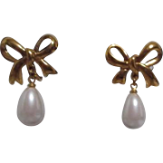 Goldtone Bow with Faux Pearl Dangle Clip-on Earrings