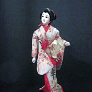 Vintage Japanese Geisha Doll Atop Music Stand