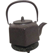 Oriental Metal Tea Pot with Decorated Trivet