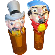 Pair of Caricaturistic Wine Stoppers