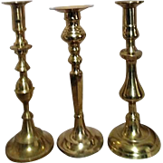 Three Tall Brass Candlesticks