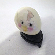 "Vintage Porcelain Hand Decorated ""Chick"" Egg on Black Stand"