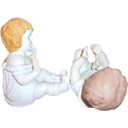 Pair of Ceramic Matt Finished Piano Babies