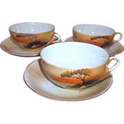 Set of three Japanese Cup and Saucers with Hand Painted Scene