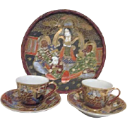 Japanese Hand Painted Wicker Framed Plate with Matching Pair of Cups and Saucers