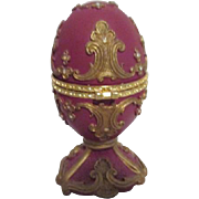 Ornate Footed Mauve Egg with Goldtone Trim Rhinestones Music Box