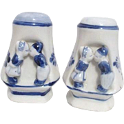 Blue and White Salt and Pepper Shakers from Holland with Boy and Girl Kissing