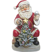 Melody in Motion Seated Christmas Santa with Christmas Tree that Lights Music Box