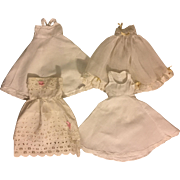 Four Lovely Vintage and Antique Slips for Bisque Dolls