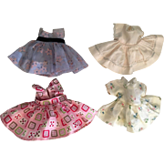 Four little dresses for 8 inch dolls such as Vogue Ginny ad Friends 1950s