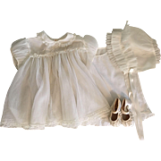 Nylon dress, slip, booties, and bonnet for big dolls and small playpens 1950s.