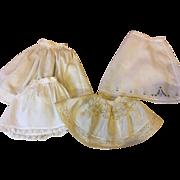 Four Vintage Doll Slips