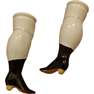 A pair of replacement doll legs