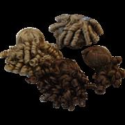 Set of 4 small to medium wigs