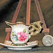 Vintage Quatrefoil Miniature Cup and Saucer with ornate gold handle