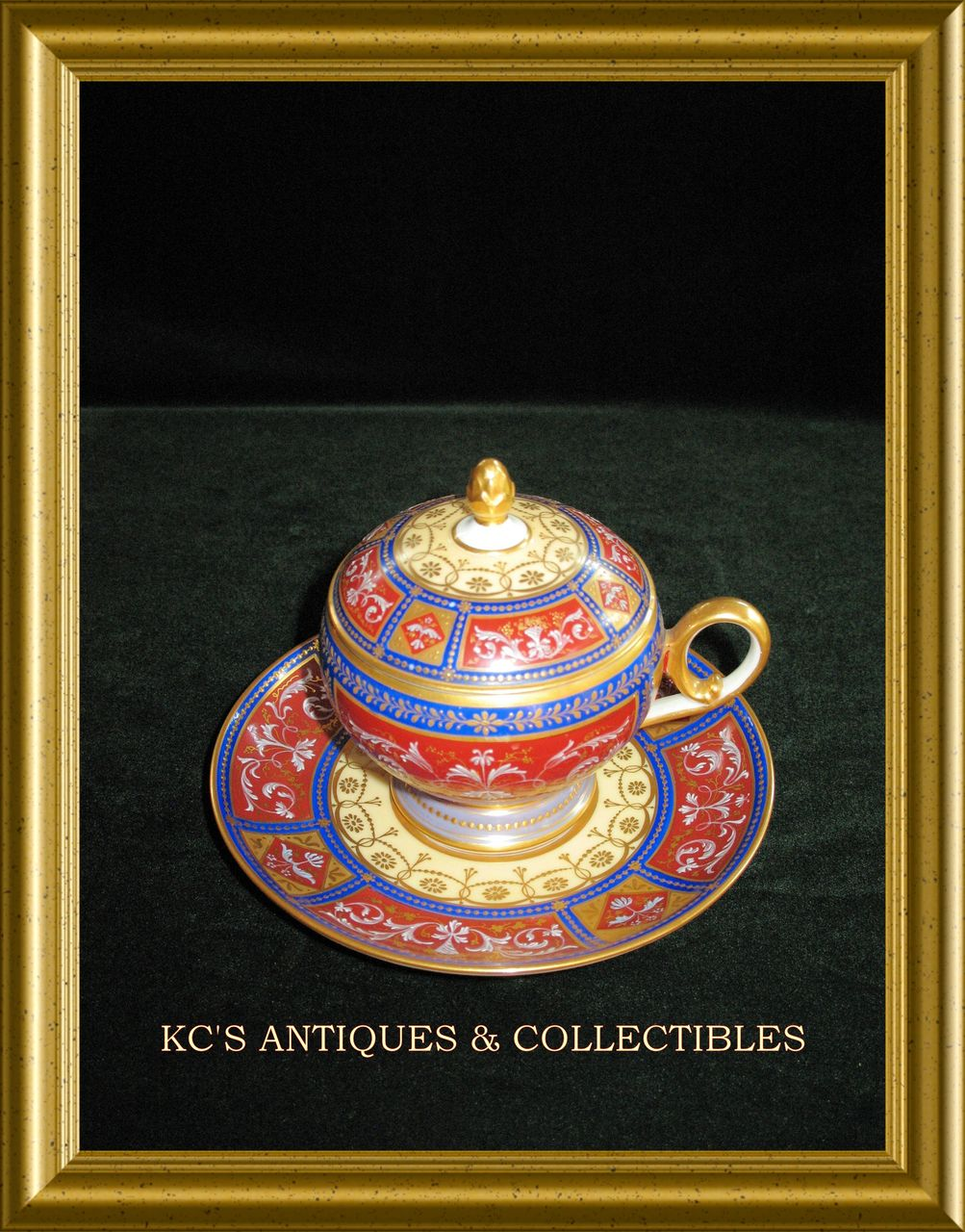 Gorgeous Royal Vienna lidded cup and saucer with gilding work (scroll and floral design) throughout