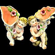 Ucagco Porcelain Cornucopia Bud  Vases  Figural Pair Cherub