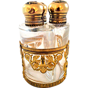 Three Perfume Bottle Set in an Ormolu Caddie