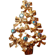 Avon Christmas Tree Brooch with Aurora Borealis Rhinestones Set in Bows