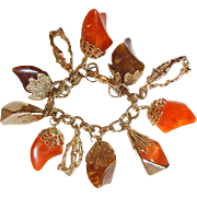 Lucite Charm Bracelet Chucks of Orange Brown and Gold