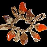 Lucite Charm Bracelet Chucks of Orange Brown and Gold