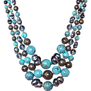 Three Strand Beaded Necklace of Turquoise Glass with Facet Plastic and Baroque Gray Pearls