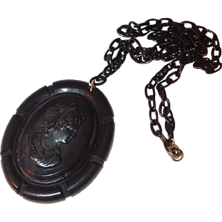 Black Bakelite Cameo Necklace with Plastic Ring Chain
